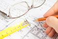 Architectural project pencil in hand and ruler close up horizontal plan of construction concept Stock Photography