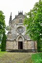 Architecture of ancient Catholic church in the neo-Gothic style Royalty Free Stock Photo