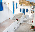 Architecture on the cyclades greek island buildings with her ty typical blue doors and white houses in summertime Stock Images