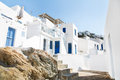 Architecture on the cyclades greek island buildings with her ty typical blue doors and white houses in summertime Royalty Free Stock Photography