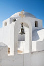 Architecture on the cyclades here church with stepple bell with blue sky Stock Photography