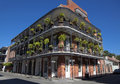 Architecture french quarter new orleans elaborate wrought iron balconies and hanging baskets on building in Stock Images