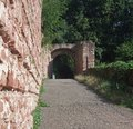 Archway around wertheim castle sunny scenery in southern germany with wall and Stock Photos