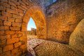 Archway to the outside with an old stone wall Royalty Free Stock Photo