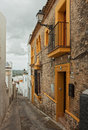 Arcos de la frontera the narrow street with old houses andalusia spain Royalty Free Stock Photos
