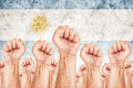 Argentina labour movement workers union strike concept with male fists raised in the air fighting for their rights argentinian Stock Image