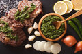 Argentine cuisine: grilled beef steak with chimichurri sauce. Ho Royalty Free Stock Photo