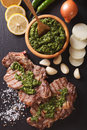 Argentine cuisine: grilled beef steak with chimichurri sauce. ve Royalty Free Stock Photo