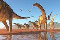 Argentinosaurus herd two deinocherius move along with a of agentinosaurus dinosaurs eating any insects and small animals that are Royalty Free Stock Photography