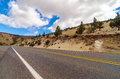 Arid highway passing through an desert in central oregon Royalty Free Stock Image