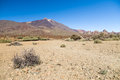Arid and stony landscape of caldera with view on volcano Teide Royalty Free Stock Photo