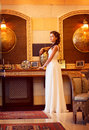 Aristocracy. Sophisticated Rich Lady standing. Orient Antique Interior Royalty Free Stock Photo