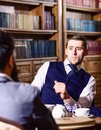 Aristocrats spend leisure in intelligent company. Tea party concept. Oldfashioned intelligent men drink tea Royalty Free Stock Photo