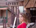 The arizona livery teenage girl in an old west town in stable Royalty Free Stock Photos