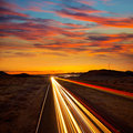 Arizona sunset at freeway with cars light traces usa Stock Image