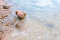 Arkose pink stone sand and seawater at the beach in chanthaburi thailand Royalty Free Stock Photo