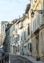 Arles bouches du rhone provence alpes cote d azur france old street and the roman arena Stock Images