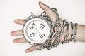 Arm chained with a clock time management Royalty Free Stock Photos