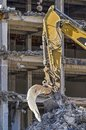 Excavator at demolition site Royalty Free Stock Photo