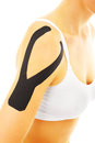 Arm injury a picture of a special physio tape put on an injured muscles over white background Stock Photo
