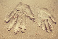 Arm print on sand the of bride and groom Stock Image