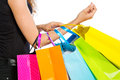 Arm with shopping bags on white background Stock Image