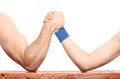 Arm wrestling between a muscular arm and skinny one close up on an uneven contest isolated on white background Stock Photo