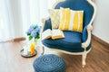 Armchair cozy with open book and decorative pillows interior and home decor concept Royalty Free Stock Photos