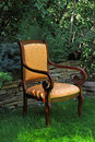 Armchair in the garden Royalty Free Stock Photo