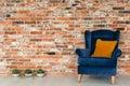 Armchair with orange pillows Royalty Free Stock Photo