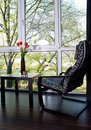 Armchair and table on balcony Royalty Free Stock Photo