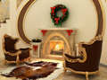 Armchairs by fireplace with Christmas-tree Royalty Free Stock Image