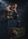 Armed man with a gun stalker post apocalyptic fiction Royalty Free Stock Images
