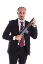 Armed mobster or businessman with shotgun Stock Photo