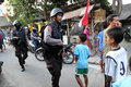 Armed police patrol in the township to capture militants in the city of solo central java indonesia Royalty Free Stock Photos