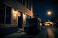 An armed security truck parked in a dark city street at night ne Royalty Free Stock Photo