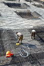 Armoring at the building site to stabilize the fundament made of workers are doing Stock Photography
