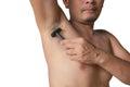 Armpits and razor hairy. Shaves a man`s armpit Royalty Free Stock Photo