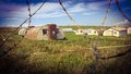 Army camp behind razor wire fence training seen through a Stock Photography