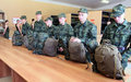 Army conscripts receiving military uniform Stock Image