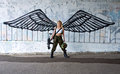 Army girl with rifle with angel wings Royalty Free Stock Photo