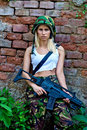 Army girl with rifle beautiful in camouflage clothes Royalty Free Stock Images