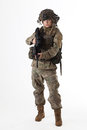Army girl shot of a beautiful uniform conforms to special services soldiers of the nato countries shot in studio isolated on white Royalty Free Stock Images