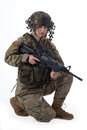 Army girl shot of a beautiful uniform conforms to special services soldiers of the nato countries shot in studio on white Stock Images