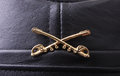 Army insignia macro shot of cavalry on a leather cap Stock Image