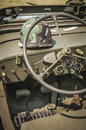 Army jeep interior u s a detail with soldier s helmet on the dash Stock Photography