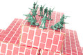 Army men guarding base green the top of red cardboard brick Stock Photos