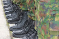 Army military boots soldiers standing in a row Stock Photo