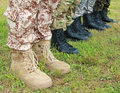 Army military boots soldiers standing in a row Royalty Free Stock Image