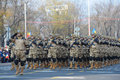 Army troops are seen during the romanian national day parade in bucgarest the capital of romania on december the st Royalty Free Stock Images